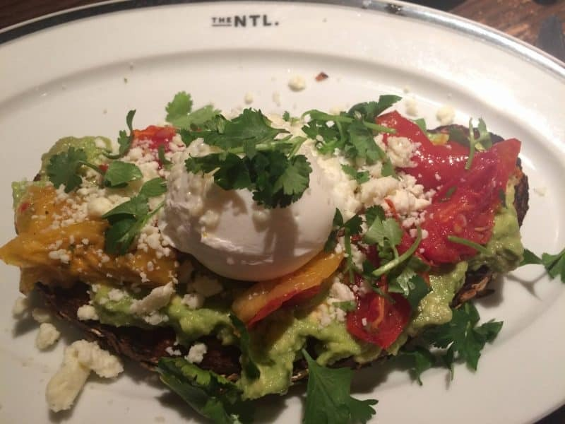 Avocado toast with poached egg at The National