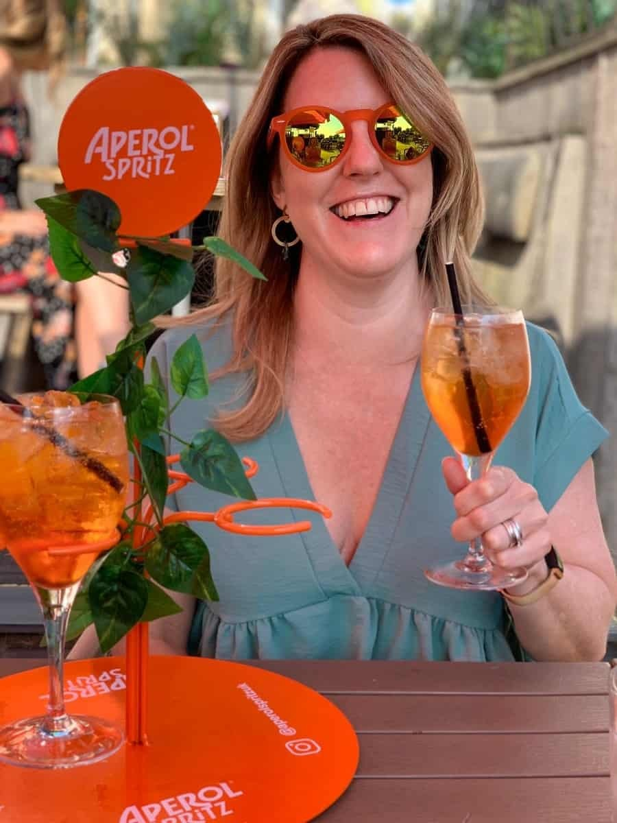 Drinking Aperol Spritz and wearing orange Aperol sunglasses