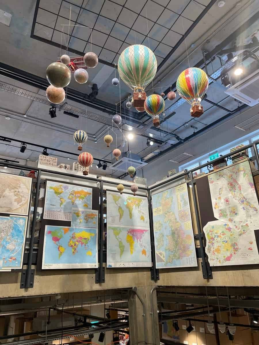 Small hot air balloons and travel maps at Stanfords book shop