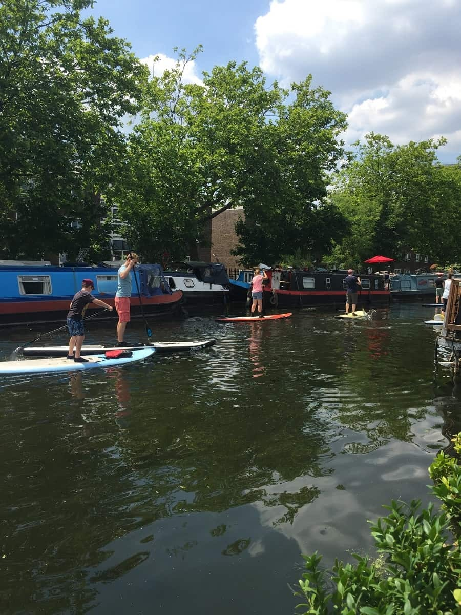 Group paddleboarding session on the canal in Paddington