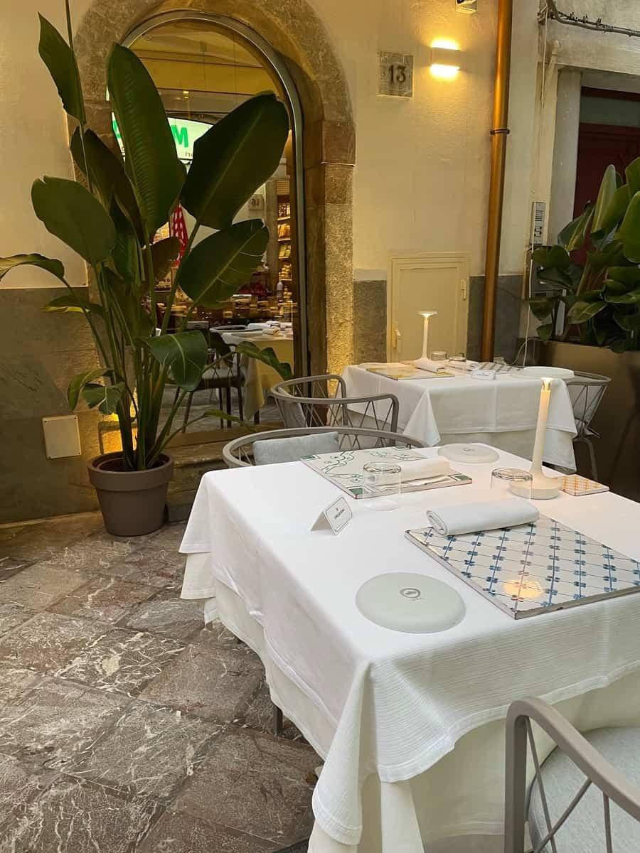 Outside tables at Vineria Modi in Taormina